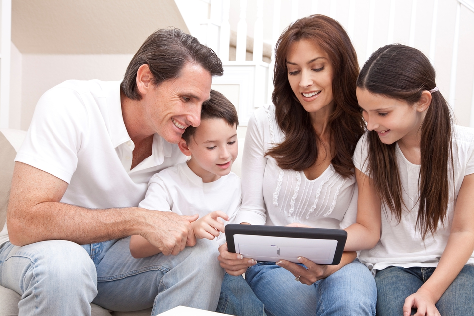 Family Looking on Tablet for Tips for Buying a New AC System