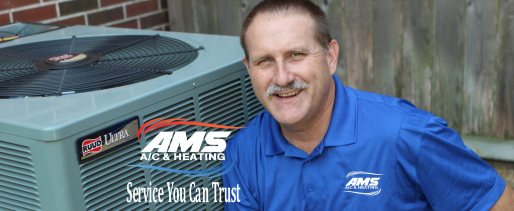 AMS Katy AC and Heating Owner Gene Henneke Next to Ruud Ultra Unit Condenser Outdoors