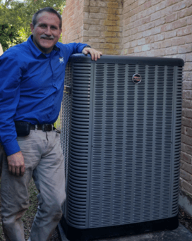 AMS Katy AC and Heating Owner Gene Henneke Next to Ruud Outside Condenser Unit