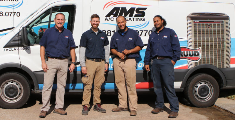 AMS AC and Heating Katy Team in Front of Company Service Trucks